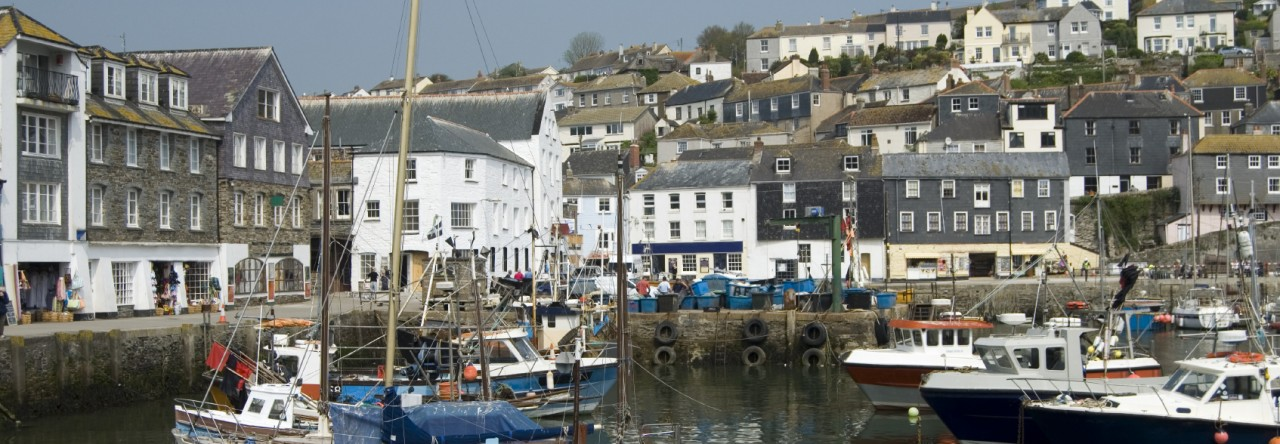 Mevagissey fishing village with boats in the harbour, Cornwall, England