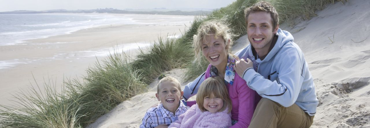 Portrait of family sitting on beach