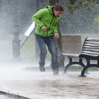 Man in heavy rain weather