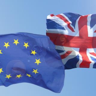 Euro and U.K. flags