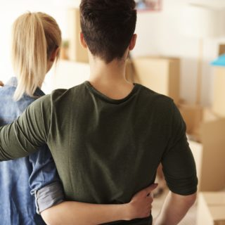young couple, first home, conveyancing, boxes