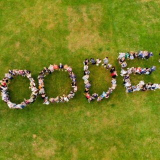 Ariel shot of Coodes staff spelling out Coodes