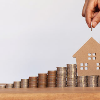 House on top of money with more being added